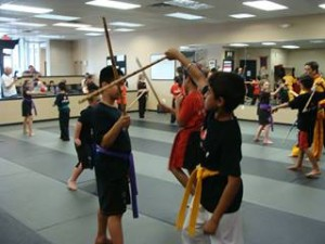 kids with sticks
