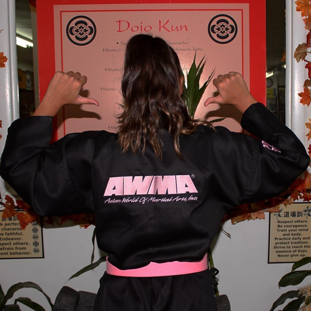 AWMA Team Member Destiny Vergara in her ProForce gi with pink detail and pink belt.  Photo courtesy of Destiny and Gerald Vergara