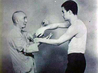 Bruce Lee and his master, Yip Man Source: Wikimedia