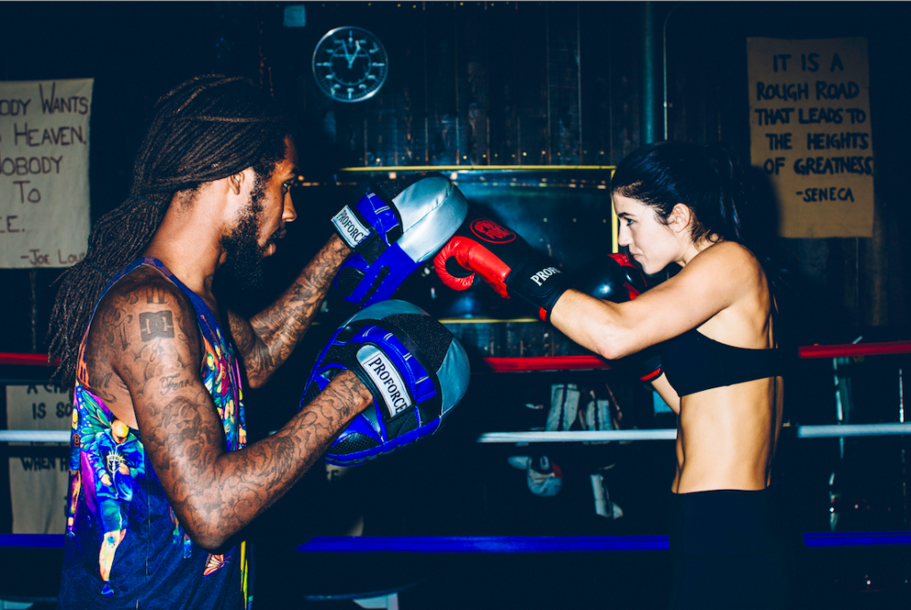 Gift Davis (left) training with a pair of his go-to ProForce focus gloves